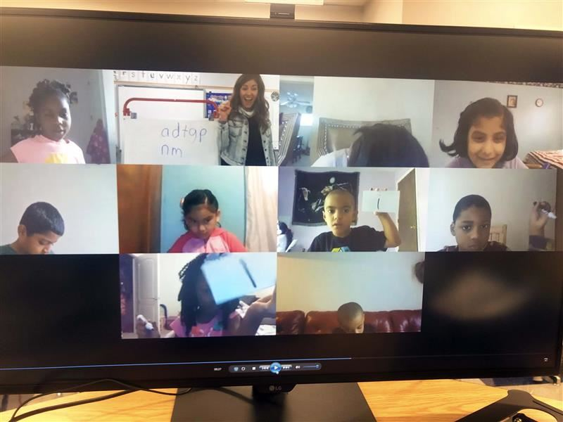 Students on a Zoom with teacher