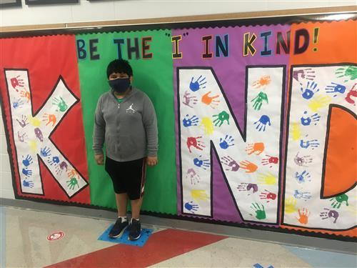 """Student posing as the """"I"""" in KIND"""