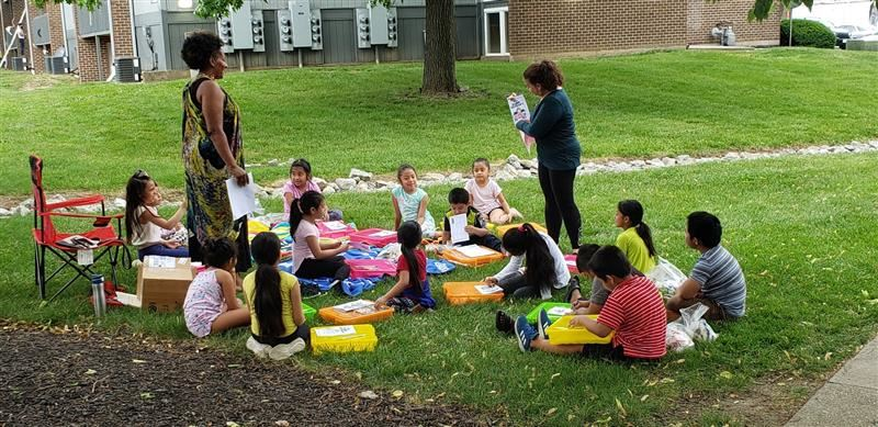 Students participating in and outdoor summer school class.